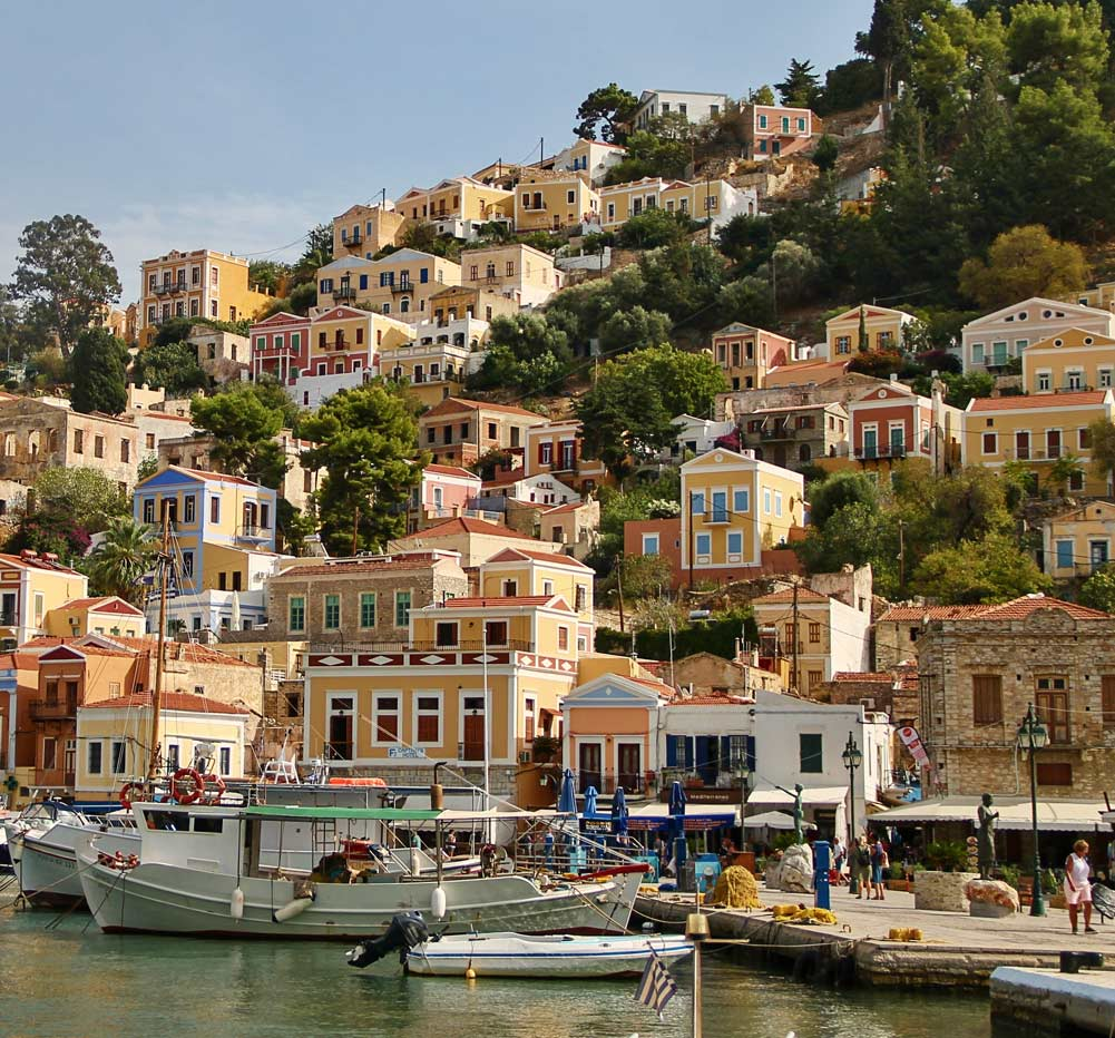 Image of small harbour against Mediterranean hillside village